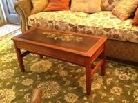 Vintage coffee table that has been hand painted.  This