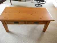 Coffee Table with 2 drawers. Some scratches on top. Can