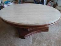 Round coffee table with marble top. Good condition.