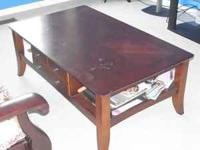 wooden coffee table with drawer, in good condition.