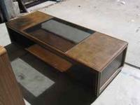 Funky solid wood and glass top tables. The end table