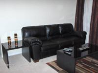 Beautiful black glass top coffee table and two end