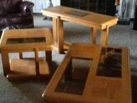 Three piece oak table set with glass insets.  Coffee