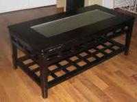 All solid wood espresso colored coffee table. In good