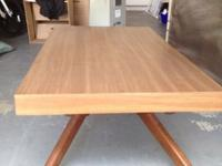 I am selling a coffee table that gets taller and turns