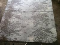 I re-purposed this coffee table by repainting a white
