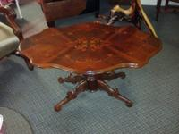 Beautiful coffee table with inlay design on top,