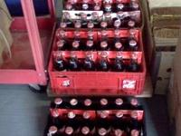 I have a bunch of 8 ounce Commerative COKE BOTTLES,all