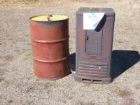 oil burning stove with 55 gal storage drum for fuel,