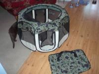 This is a fabulous collapsible dog pen that folds up