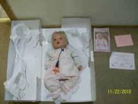 i have two collectible dolls that are very sweet.