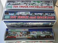 Collectible Hess Toy Trucks from 1986 to 2011. Mint in