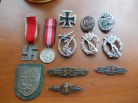 Collection of 26 original german medals, insignia and