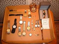 FOR SALE-- A collection of watches. One is a Tiara with