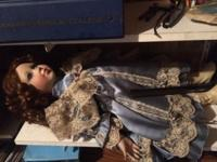 Porcelain collectors doll. Must pick up in Monroe,