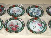 "I have a set of 8 collectors humming bird plates, ""Lena"