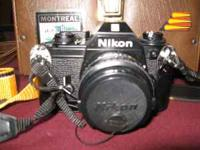 Nikon EM 35mm Camera. $50.00 firm! Case 135mm Telephoto