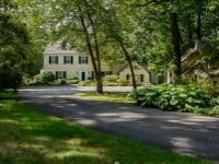 This Charming Colonial Surrounded By English Gardens Is