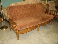 Nice colonial style sofa with sturdy oak frame and rust