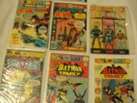 For sale are seven comic books featuring Batman from