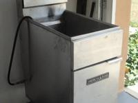 American Brand Deep Fryer- uses natural gas. Barely