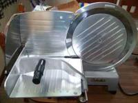This is a Cabela's Commercial Grade Meat Slicer with a
