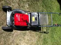 Commercial Homda LawnMower, works great.  Location: