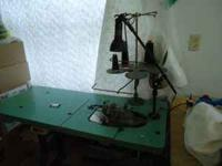 1 COMMERCIAL SERGER. WE ALSO HAVE 1RUFFLING MACHINE.