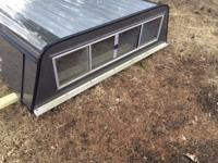 Grey fiberglass truck topper/cap with steel shelving