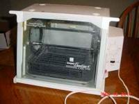 Works perfect. Comes with a basket for small items. If