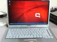 Compaq Persario v2000 laptop works great! Comes with