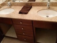 All together double sinks, vanity, faucets and a marble