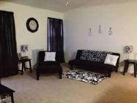 This set includes a sofa, chair and ottoman. All are