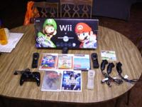 Complete Nintendo WII system with extras Comes with