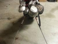 Complete set of golf clubs with Cleveland driver,