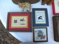 Very nice completed cross stitch. All are framed except