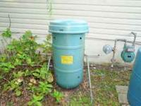 Compost barrel. 40 inches tall, 18 inches wide. Rotates