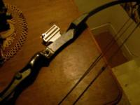 Compound bow with fiber glass bows and cast aluminum