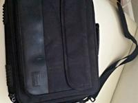 Black computer bag with plenty of room for charger,