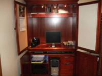 Nice strong wood computer system desk. When not in use,