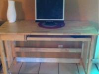 Hello there. I am selling a oak wood computer desk that