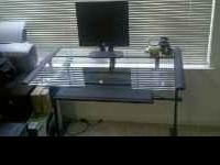 This is a very nice glass top desk with a roll out
