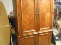 This is a beautiful oak computer armoire/secretary. The