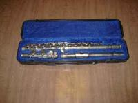 Concert Flute with Case Asking $75.  Location: Silver