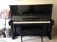 Beautiful black Schafer and Sons upright piano with