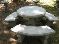 This is a solid concrete table set that comes with