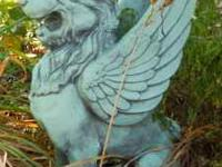 This Mythological Griffin yard decoration is solid