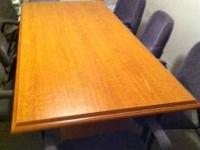 7 foot, oak finish conference table in great condition.