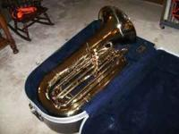 Conn 15J Tuba with hard shell case. Like new condition.