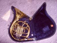 Conn french horn with case . Dented but works fine.